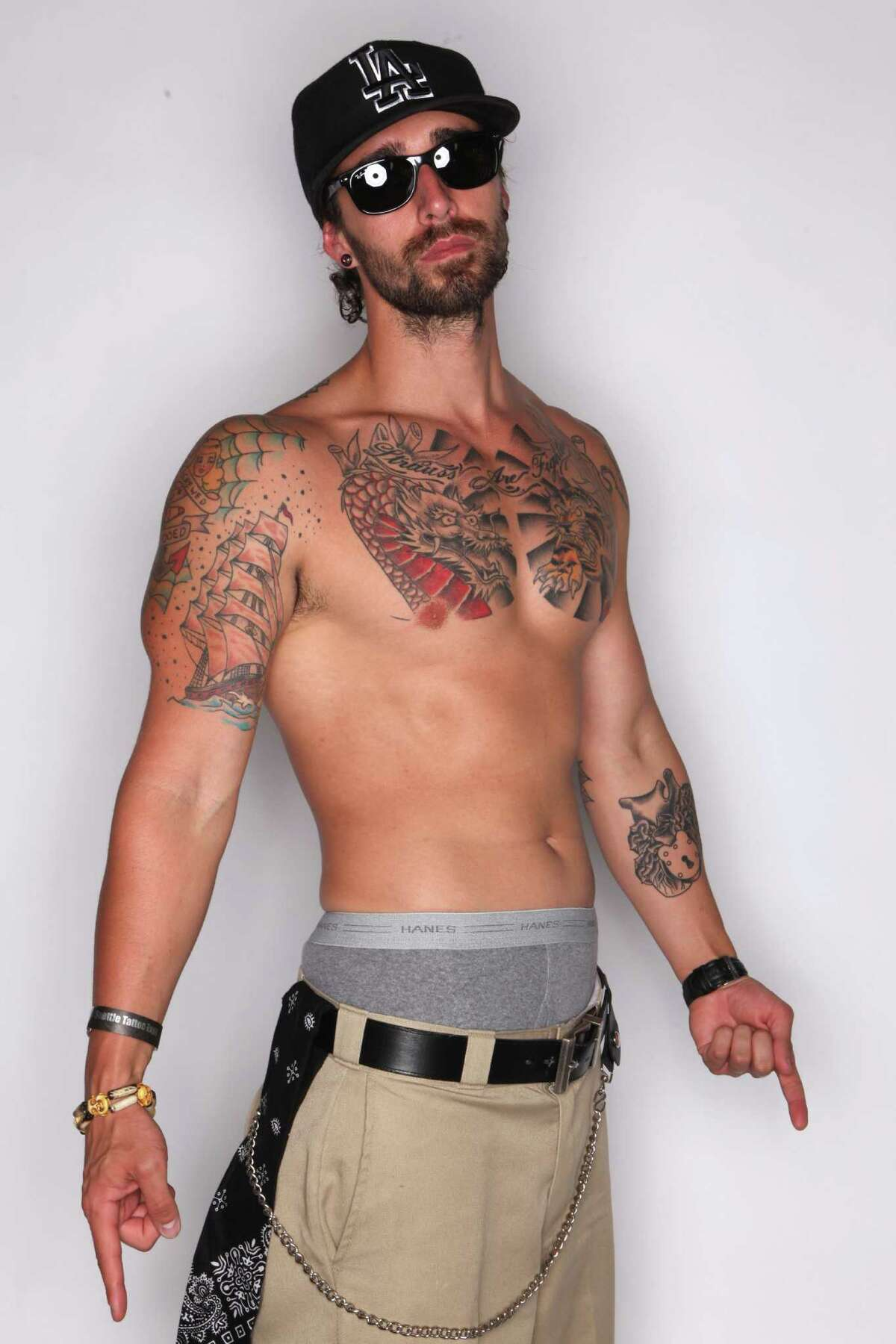 J. Strauss shows some of his tattoos at the Seattle Tattoo Expo.