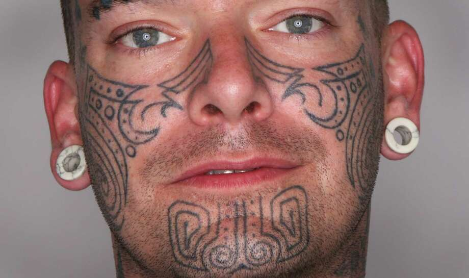 Jake King of Seattle shows his face tattoos at the Seattle Tattoo Expo on Saturday. Photo: JOSHUA TRUJILLO / SEATTLEPI.COM