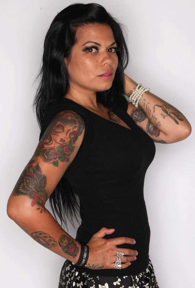 Krissy Logan of Portland shows some of her tattoos. Photo: JOSHUA TRUJILLO / SEATTLEPI.COM