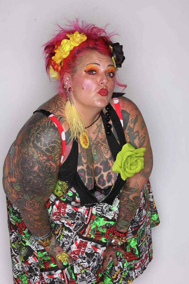 Majenta of Diamond Tattoo in Renton shows some of her ink. Photo: JOSHUA TRUJILLO / SEATTLEPI.COM