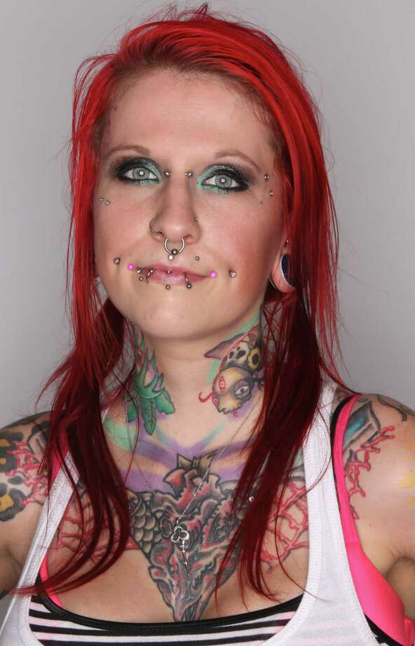 Krista Sardotz of Tacoma shows some of her ink and piercings at the Seattle Tattoo Expo. Photo: JOSHUA TRUJILLO / SEATTLEPI.COM