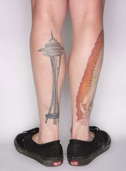 Ashley Whitson shows her Space Needle tattoo from Sergio at Pioneer Tattoo during the Seattle Tattoo