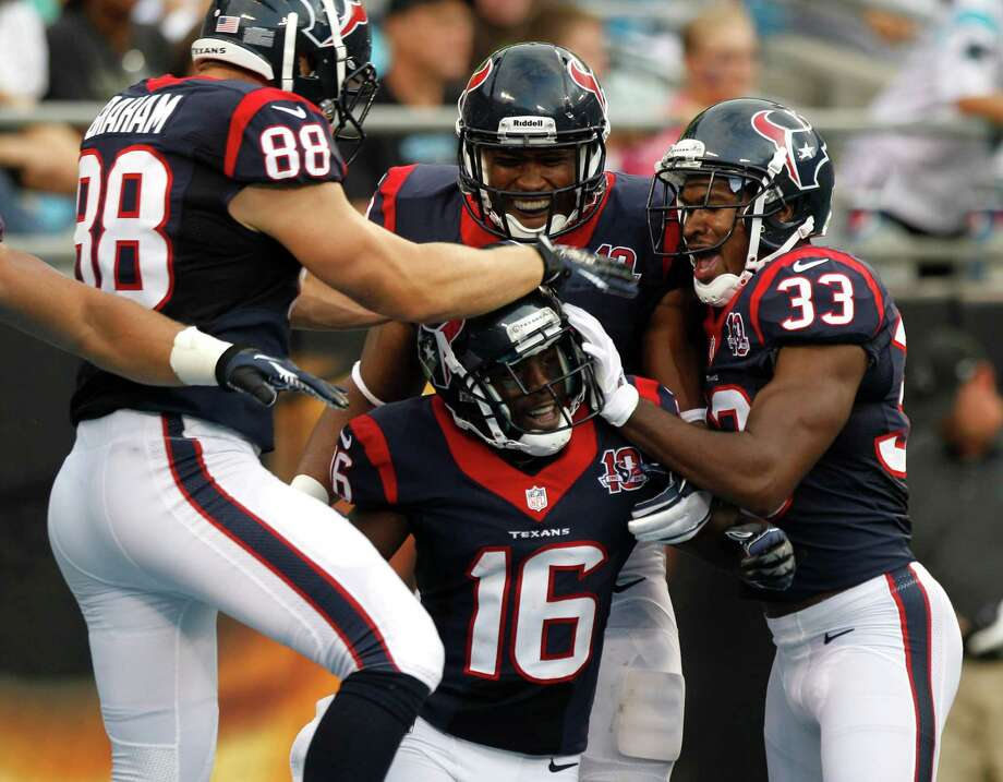 If Trindon Holliday (16) can survive the pounding he gets while being mobbed by his teammates after one of his long kickoff returns, then the Texans figure he's tough enough to play in the NFL. Photo: Brett Coomer / © 2012  Houston Chronicle