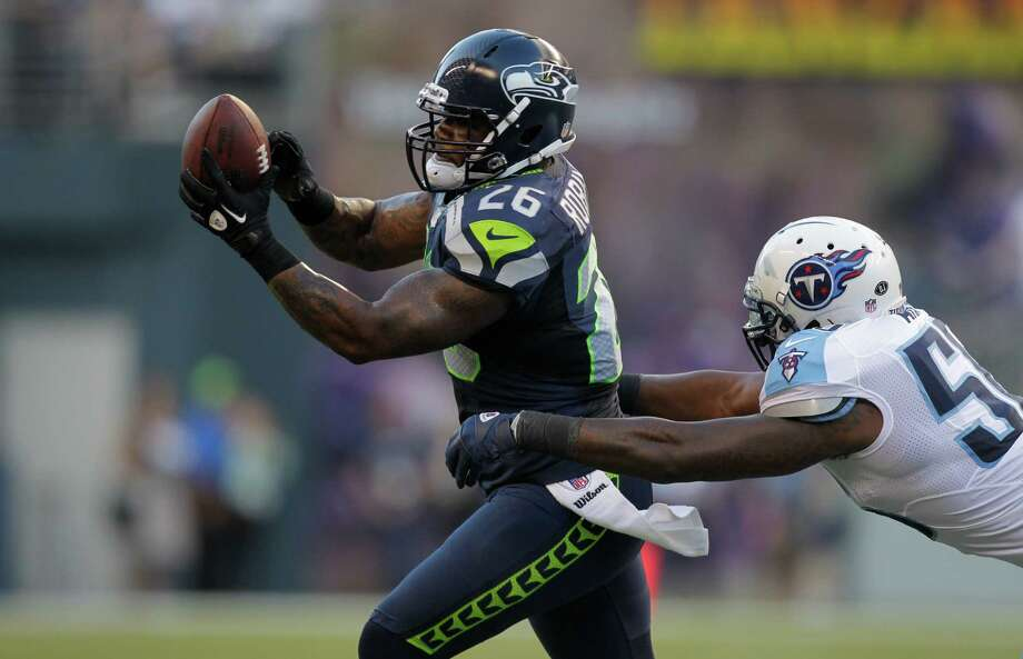 Seattle Seahawks fullback Michael Robinson  pulls in a passin front of Tennessee Titans linebacker Akeem Ayers Photo: Ap