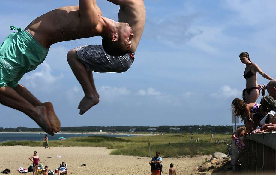 People jump off 'Jaws Bridge' during JawsFest: The Tribute, a festival celebrating the film Jaws, on the island of Martha's Vineyard on August 11, 2012 in Edgartown, Massachusetts. The film was primarily shot in Martha's Vineyard and tells the story of a massive great white shark who attacks humans along the coast of the fictional Amity Island. In the film, the great white shark swims through the channel beneath the bridge to kill a boater in a seaside pond. A man was confirmed to have been bitten by a great white shark less than two weeks ago along the shoreline of nearby Cape Cod. An increase in the seal population on Cape Cod has led to increased shark sightings including great whites. Photo: Mario Tama, Getty Images