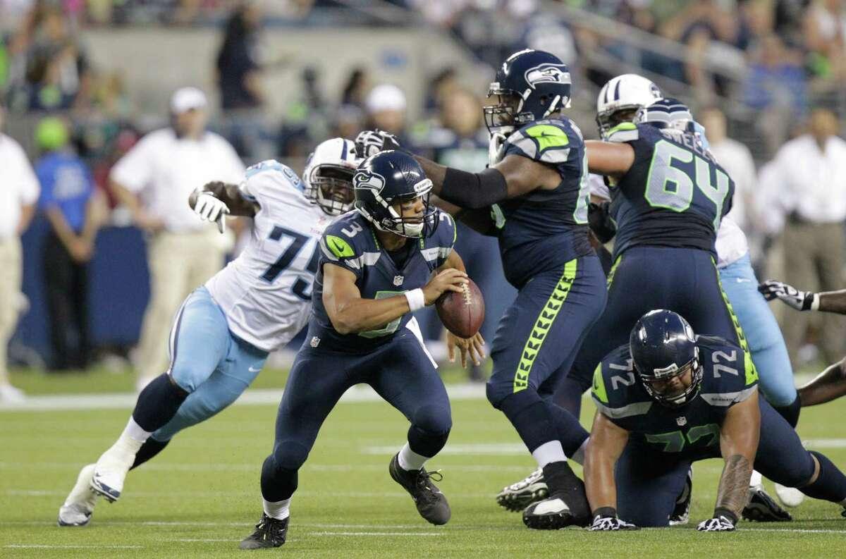 Tennessee Titans' Keyunta Dawson (75) puts pressure on Seattle Seahawks quarterback Russell Wilson in the second half.