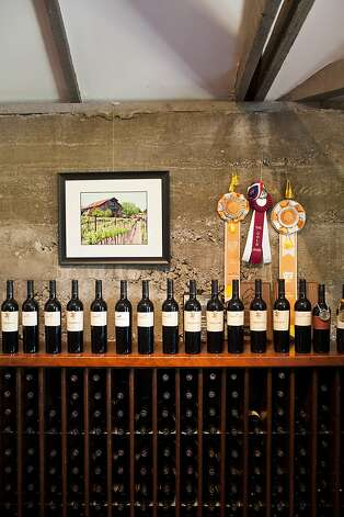 Awards hang on the wall above the wines offered at the Murrieta's Well tasting room in Livermore, Calif., August 1, 2012. Jason Henry/Special to The Chronicle Photo: Jason Henry, Special To The Chronicle