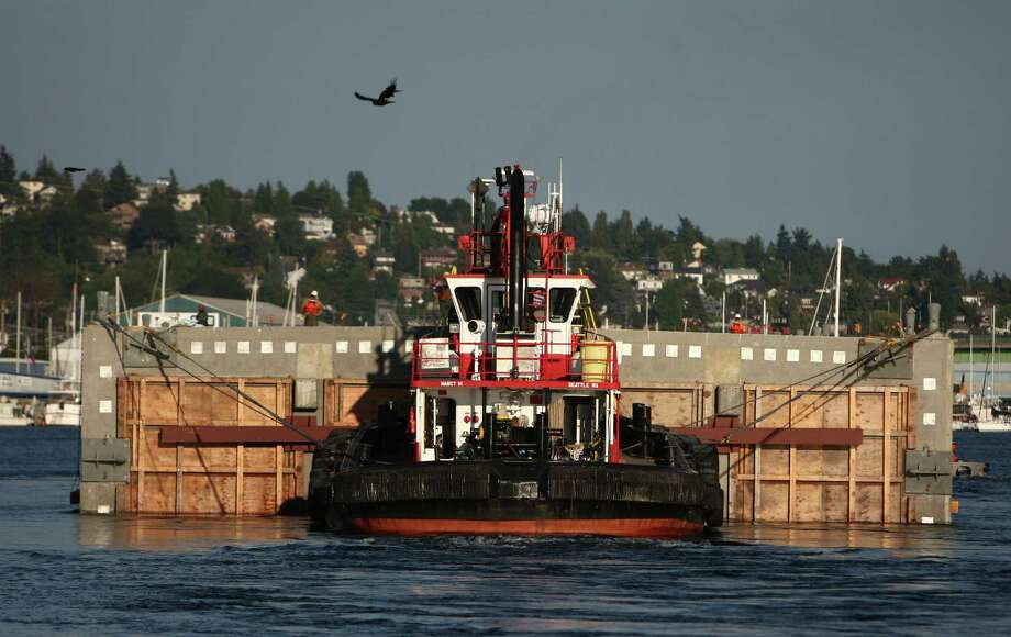 The first of the new 520 bridge pontoons departs the Ballard Locks and continues its journey to Lake Washington. Photo: JOSHUA TRUJILLO / SEATTLEPI.COM
