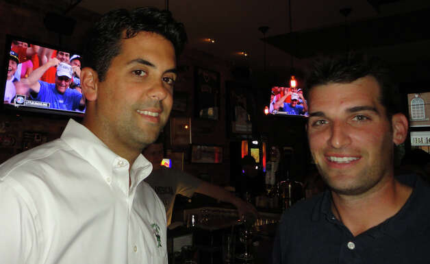 Ken Martin, left, and Paul Coniglio, two of the four owners of Colony Grill on Post Road, watched the TV broadcast of the game from their restaurant Saturday as they reminisced about their World Series win in 1989 as members of the Trumbull Little League team. Business partners Chris Drury and Cody Lee were also on that same national championship team. Photo: Meg Barone / Fairfield Citizen freelance