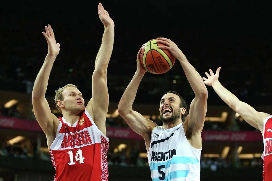 LONDON, ENGLAND - AUGUST 12:  Manu Ginobili #5 of Argentina drives to the basket against Anton Ponkrashov #14 of Russia during the Men's Basketball bronze medal game between Russia and Argentina on Day 16 of the London 2012 Olympics Games at North Greenwich Arena on August 12, 2012 in London, England. Photo: Christian Petersen, Getty Images / 2012 Getty Images