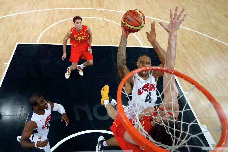 LONDON, ENGLAND - AUGUST 12:  (EDITORS NOTE: A polarizing filter was used for this image.) Tyson Chandler #4 of the United States takes the ball to the basket during the Men's Basketball gold medal game between the United States and Spain on Day 16 of the London 2012 Olympics Games at North Greenwich Arena on August 12, 2012 in London, England. Photo: Christian Petersen, Getty Images / 2012 Getty Images
