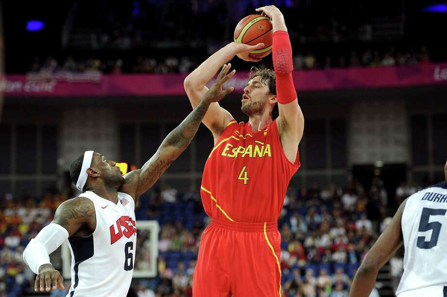 LONDON, ENGLAND - AUGUST 12:  Pau Gasol #4 of Spain shoots against LeBron James #6 of the United States during the Men's Basketball gold medal game between the United States and Spain on Day 16 of the London 2012 Olympics Games at North Greenwich Arena on August 12, 2012 in London, England. Photo: Harry How, Getty Images / 2012 Getty Images