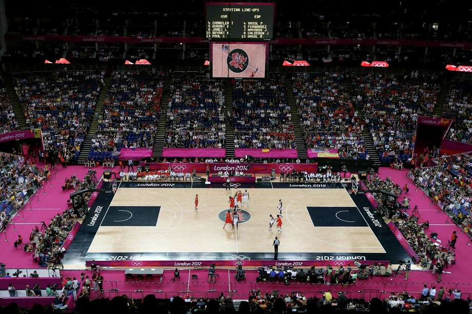 LONDON, ENGLAND - AUGUST 12:  A general view as Tyson Chandler #4 of the United States and Pau Gasol #4 of Spain contest the tip off in the Men's Basketball gold medal game between the United States and Spain on Day 16 of the London 2012 Olympics Games at North Greenwich Arena on August 12, 2012 in London, England. Photo: Streeter Lecka, Getty Images / 2012 Getty Images