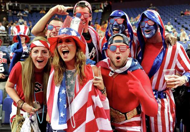 LONDON, ENGLAND - AUGUST 12:  Fans of the United States support their team against Spain during the Men's Basketball gold medal game on Day 16 of the London 2012 Olympics Games at North Greenwich Arena on August 12, 2012 in London, England. Photo: Harry How, Getty Images / 2012 Getty Images