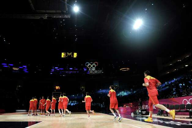 LONDON, ENGLAND - AUGUST 12:  The Spainish team run out onto the court ahead the Men's Basketball gold medal game between the United States and Spain on Day 16 of the London 2012 Olympics Games at North Greenwich Arena on August 12, 2012 in London, England. Photo: Harry How, Getty Images / 2012 Getty Images
