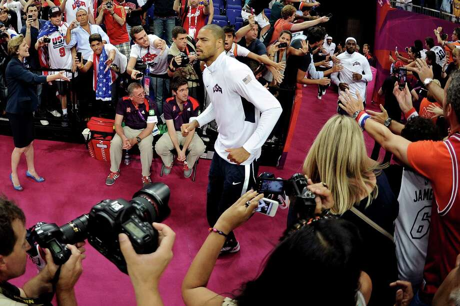 LONDON, ENGLAND - AUGUST 12:  Tyson Chandler #4 of of the United States runs out to the court to play against Spain during the Men's Basketball gold medal game on Day 16 of the London 2012 Olympics Games at North Greenwich Arena on August 12, 2012 in London, England. Photo: Harry How, Getty Images / 2012 Getty Images