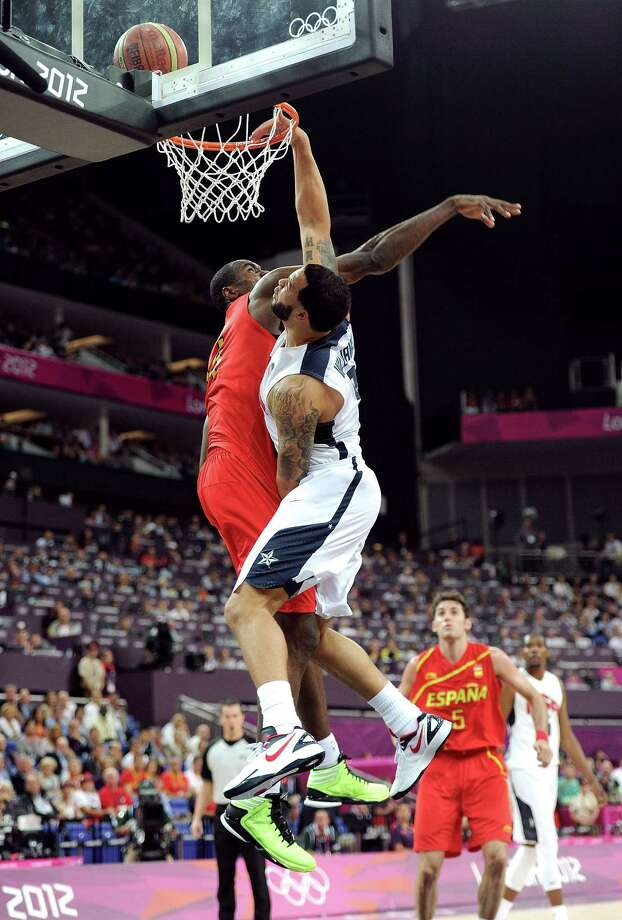 LONDON, ENGLAND - AUGUST 12:  Deron Williams #8 of the United States dunks on Serge Ibaka #14 of Spain during the Men's Basketball gold medal game between the United States and Spain on Day 16 of the London 2012 Olympics Games at North Greenwich Arena on August 12, 2012 in London, England. Photo: Harry How, Getty Images / 2012 Getty Images