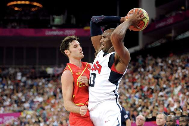 LONDON, ENGLAND - AUGUST 12:  Kobe Bryant #10 of the United States looks to pass the ball against Rudy Fernandez #5 of Spain during the Men's Basketball gold medal game between the United States and Spain on Day 16 of the London 2012 Olympics Games at North Greenwich Arena on August 12, 2012 in London, England. Photo: Harry How, Getty Images / 2012 Getty Images