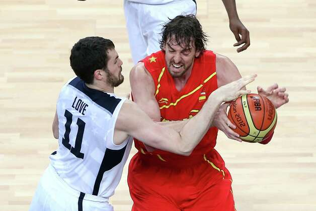 LONDON, ENGLAND - AUGUST 12:  Pau Gasol #4 of Spain competes with Kevin Love #11 of the United States during the Men's Basketball gold medal game between the United States and Spain on Day 16 of the London 2012 Olympics Games at North Greenwich Arena on August 12, 2012 in London, England. Photo: Streeter Lecka, Getty Images / 2012 Getty Images
