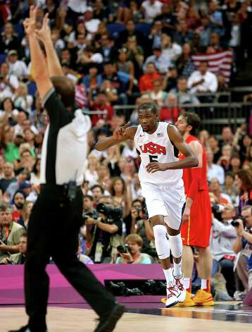 LONDON, ENGLAND - AUGUST 12:  Kevin Durant #5 of the United States celebrates making a three point shot during the Men's Basketball gold medal game between the United States and Spain on Day 16 of the London 2012 Olympics Games at North Greenwich Arena on August 12, 2012 in London, England. Photo: Christian Petersen, Getty Images / 2012 Getty Images