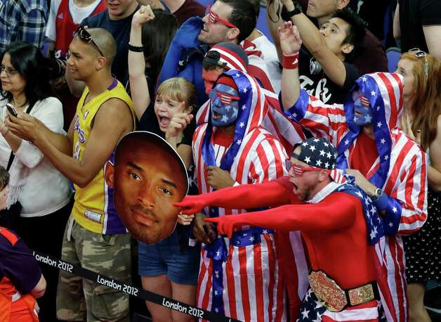 Fans cheer for the United States men's basketball team during the gold medal basketball game against Spain at the 2012 Summer Olympics, Sunday, Aug. 12, 2012, in London. (AP Photo/Victor Caivano) Photo: Victor Caivano, Associated Press / AP