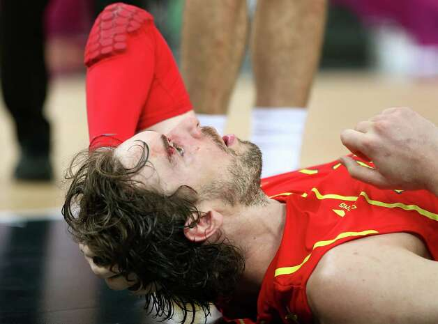 LONDON, ENGLAND - AUGUST 12:  Pau Gasol #4 of Spain lies on the court after he was struck in the face during the Men's Basketball gold medal game between the United States and Spain on Day 16 of the London 2012 Olympics Games at North Greenwich Arena on August 12, 2012 in London, England. Photo: Christian Petersen, Getty Images / 2012 Getty Images