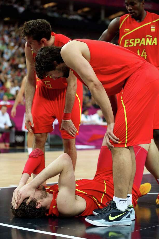 LONDON, ENGLAND - AUGUST 12:  Pau Gasol #4 of Spain lies on the court after he was struck in the face as team mates come to his aid during the Men's Basketball gold medal game between the United States and Spain on Day 16 of the London 2012 Olympics Games at North Greenwich Arena on August 12, 2012 in London, England. Photo: Christian Petersen, Getty Images / 2012 Getty Images