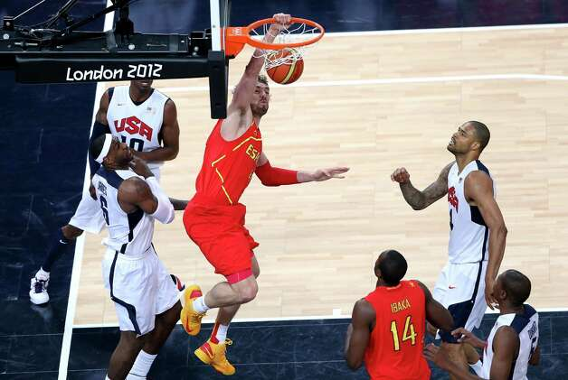 LONDON, ENGLAND - AUGUST 12:  Pau Gasol #4 of Spain slam dunks during the Men's Basketball gold medal game between the United States and Spain on Day 16 of the London 2012 Olympics Games at North Greenwich Arena on August 12, 2012 in London, England. Photo: Streeter Lecka, Getty Images / 2012 Getty Images