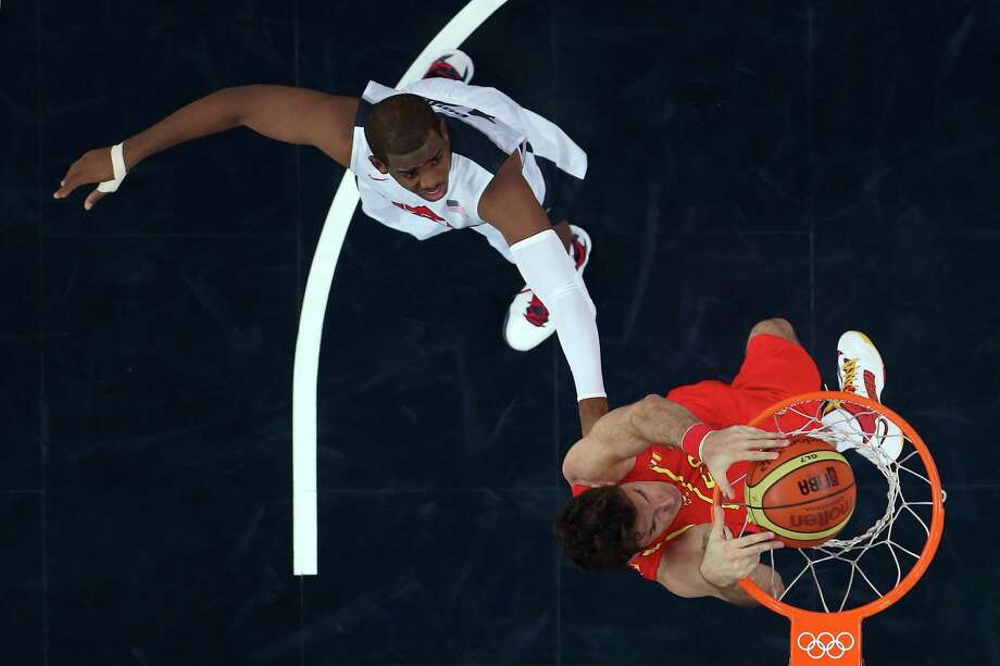 LONDON, ENGLAND - AUGUST 12:  Felipe Reyes #9 of Spain dunks over Andre Iguodala #9 of the United States during the Men's Basketball gold medal game between the United States and Spain on Day 16 of the London 2012 Olympics Games at North Greenwich Arena on August 12, 2012 in London, England. Photo: Christian Petersen, Getty Images / 2012 Getty Images