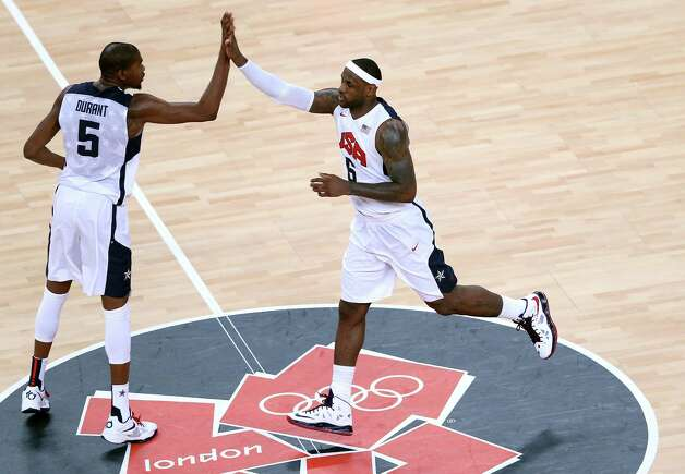 LONDON, ENGLAND - AUGUST 12: LeBron James #6 of the United States and Kevin Durant #5 of the United States celebrate a basket during the Men's Basketball gold medal game between the United States and Spain on Day 16 of the London 2012 Olympics Games at North Greenwich Arena on August 12, 2012 in London, England. Photo: Streeter Lecka, Getty Images / 2012 Getty Images