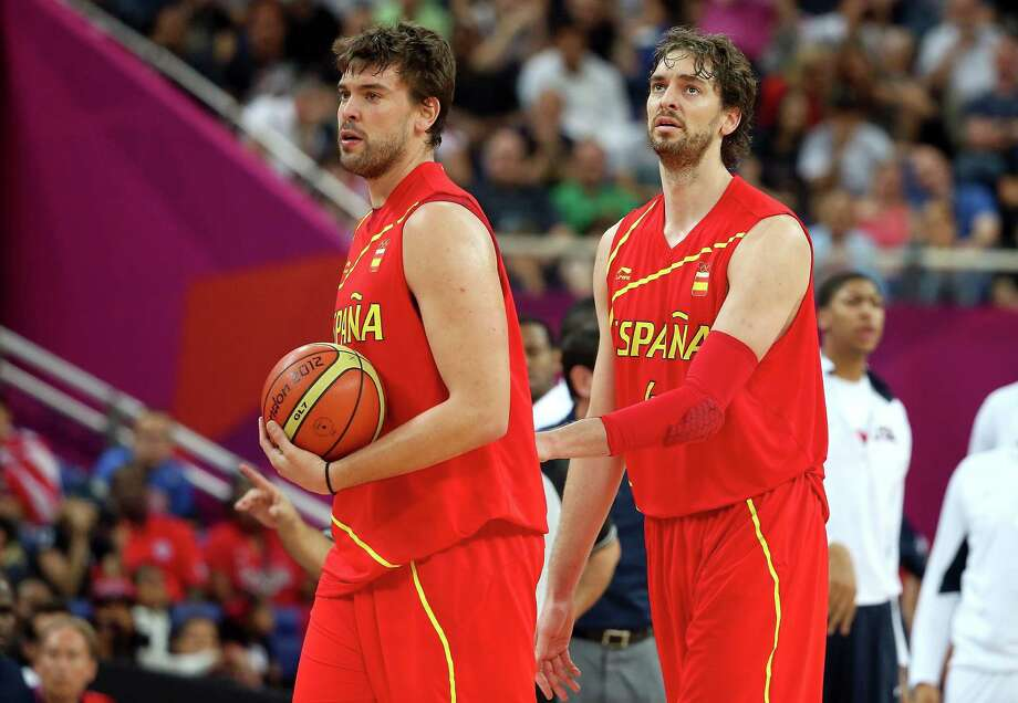 LONDON, ENGLAND - AUGUST 12:  Pau Gasol #4 of Spain and Marc Gasol #13 of Spain look on during the Men's Basketball gold medal game between the United States and Spain on Day 16 of the London 2012 Olympics Games at North Greenwich Arena on August 12, 2012 in London, England. Photo: Christian Petersen, Getty Images / 2012 Getty Images