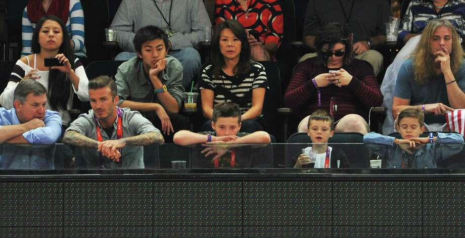LONDON, ENGLAND - AUGUST 12:  (L-R) AEG President Tim Leiweke sits with David Beckham and his sons Brooklyn Beckham, Cruz Beckham and Romeo Beckham during the Men's Basketball gold medal game between the United States and Spain on Day 16 of the London 2012 Olympics Games at North Greenwich Arena on August 12, 2012 in London, England. Photo: Pascal Le Segretain, Getty Images / 2012 Getty Images
