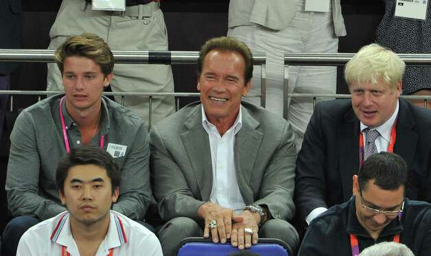 LONDON, ENGLAND - AUGUST 12:  (L-R) Patrick Schwarzenegger, Arnold Schwarzenegger and London Mayor Boris Johnson during the Men's Basketball gold medal game between the United States and Spain on Day 16 of the London 2012 Olympics Games at North Greenwich Arena on August 12, 2012 in London, England. Photo: Pascal Le Segretain, Getty Images / 2012 Getty Images