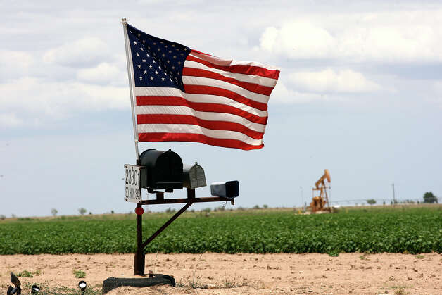 The U.S. Flag flies over mailboxes by farmland along Texas State Highway 349 between Midland and Rankin, Texas, Thursday, July 26, 2012. Photo: Jerry Lara, Jerry Lara/Express-News / © 2012 San Antonio Express-News