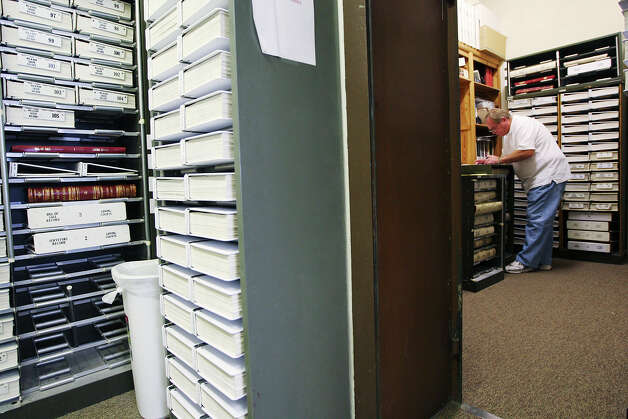 Independent landman Ben Brown of Shreveport, LA, checks records in Loving County Courthouse in Mentone, Texas, Wednesday, July 25, 2012. With 85 permanent residents, it is the county with the least population in the country. It is augmented with around 1,000 to 1,500 workers that descend on the county during work hours. Photo: Jerry Lara, Jerry Lara/Express-News / © 2012 San Antonio Express-News