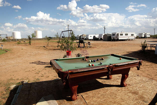 A pool table provides some entertainment for residents at E&D RV Parks near Stanton, Texas, Wednesday, July 25, 2012. The park opened after demand for housing rose due to the oil and gas boom in the Permian Basin. Photo: Jerry Lara, Jerry Lara/Express-News / © 2012 San Antonio Express-News