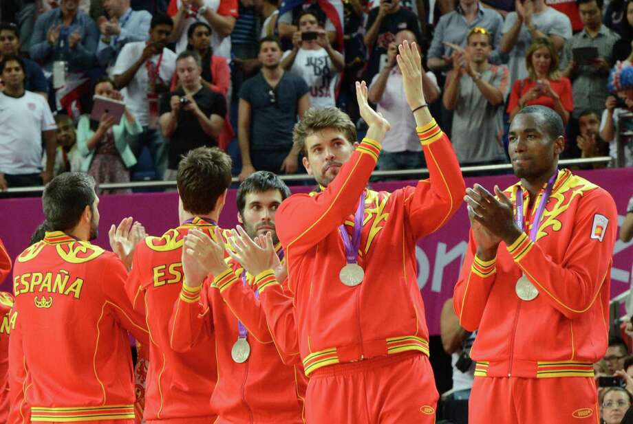Spain's players pose on the podium after winning the silver medal in the London 2012 Olympic Games men's basketball competition at the North Greenwich Arena in London on August 12, 2012. The US won the gold medal followed by the silver to Spain and the bronze to Russia. AFP PHOTO /MARK RALSTONMARK RALSTON/AFP/GettyImages Photo: MARK RALSTON, AFP/Getty Images / AFP