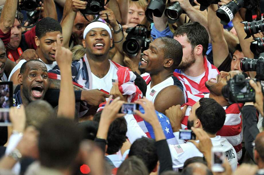 LONDON, ENGLAND - AUGUST 12:  (L-R) LeBron James #6, Carmelo Anthony #15 and Kevin Durant #5 of the United States celebrate after they won against Spain during the Men's Basketball gold medal game on Day 16 of the London 2012 Olympics Games at North Greenwich Arena on August 12, 2012 in London, England. Photo: Pascal Le Segretain, Getty Images / 2012 Getty Images