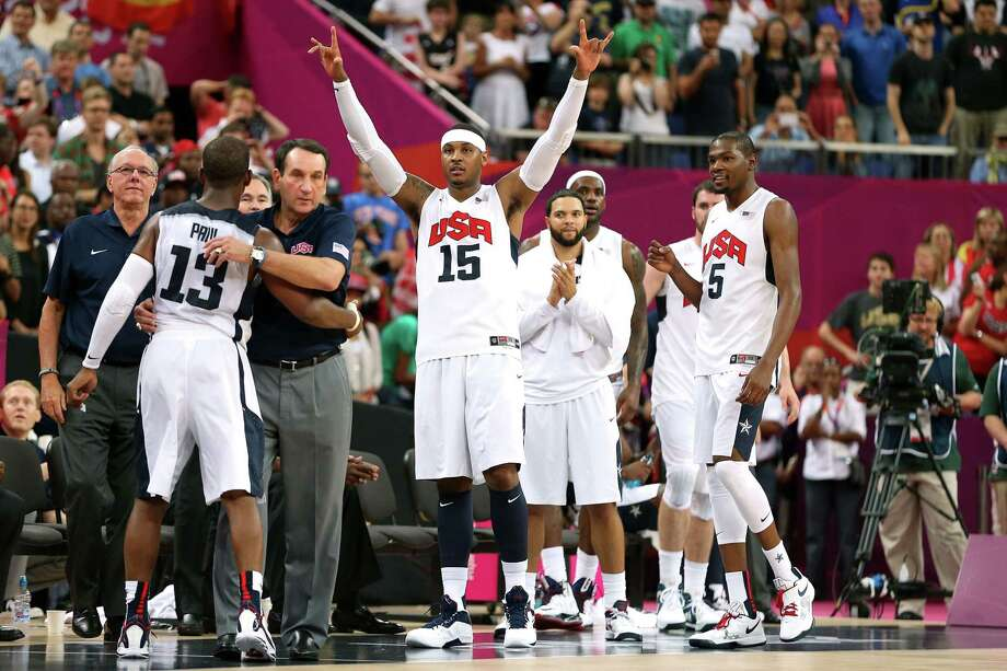 LONDON, ENGLAND - AUGUST 12:  Carmelo Anthony #15 of the United States and team mates celebrate in the Men's Basketball gold medal game between the United States and Spain on Day 16 of the London 2012 Olympics Games at North Greenwich Arena on August 12, 2012 in London, England. Photo: Christian Petersen, Getty Images / 2012 Getty Images