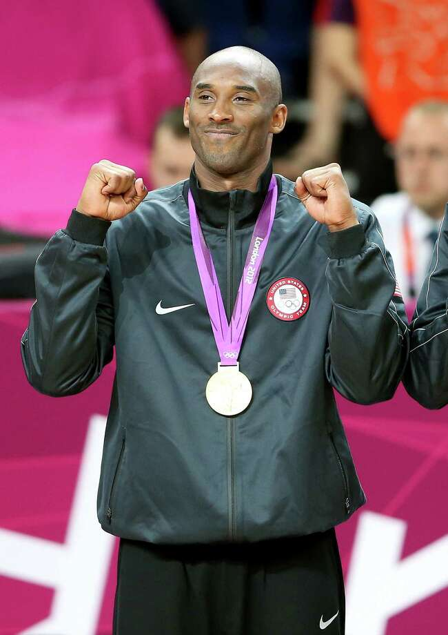 LONDON, ENGLAND - AUGUST 12:  Kobe Bryant #10 of the United States celebrates on the podium during the medal ceremony for the Men's Basketball gold medal game between the United States and Spain on Day 16 of the London 2012 Olympics Games at North Greenwich Arena on August 12, 2012 in London, England. Photo: Streeter Lecka, Getty Images / 2012 Getty Images