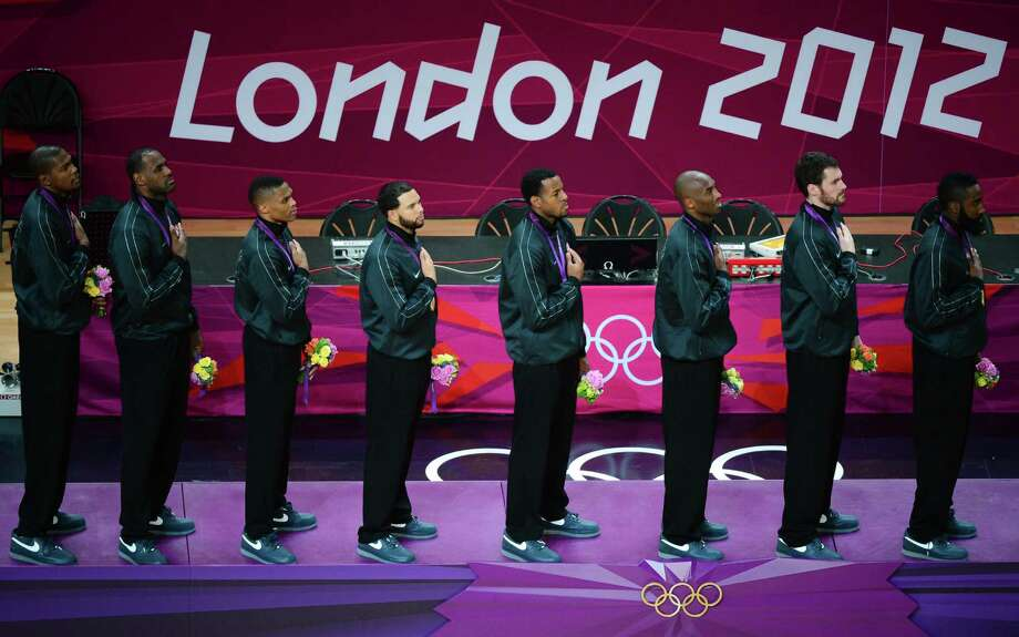 US players pose on the podium after winning the gold medal for the London 2012 Olympic Games men's basketball competition at the North Greenwich Arena in London on August 12, 2012. The US won the gold medal followed by the silver to Spain and the bronze to Russia. AFP PHOTO /EMMANUEL DUNANDEMMANUEL DUNAND/AFP/GettyImages Photo: EMMANUEL DUNAND, AFP/Getty Images / AFP