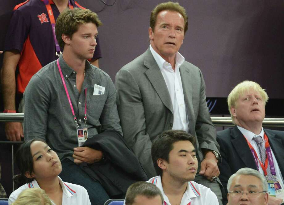 LONDON, ENGLAND - AUGUST 12:  (L-R) Patrick Schwarzenegger, Arnold Schwarzenegger and London Mayor Boris Johnson during the Men's Basketball gold medal game between the United States and Spain on Day 16 of the London 2012 Olympics Games at North Greenwich Arena on August 12, 2012 in London, England. Photo: Harry How, Getty Images / 2012 Getty Images