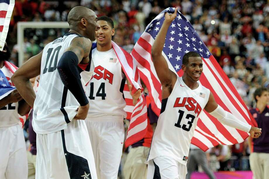 LONDON, ENGLAND - AUGUST 12:  Team mates Kobe Bryant #10 of the United States, Anthony Davis #14 of the United States, and Chris Paul #13 of the United States celebrate winning the Men's Basketball gold medal game between the United States and Spain on Day 16 of the London 2012 Olympics Games at North Greenwich Arena on August 12, 2012 in London, England. The United States won the match 107-100. Photo: Harry How, Getty Images / 2012 Getty Images