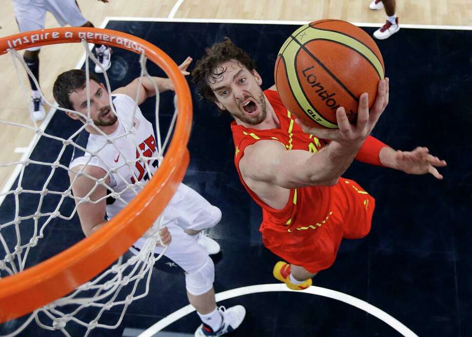 LONDON, ENGLAND - AUGUST 12:  Pau Gasol of Spain drives past Kevin Love of the United States to score during the Men's Basketball Gold medal game between the United States and Spain on Day 16 of the London 2012 Olympics Games at North Greenwich Arena on August 12, 2012 in London, England. Photo: Pool, Getty Images / 2012 Getty Images
