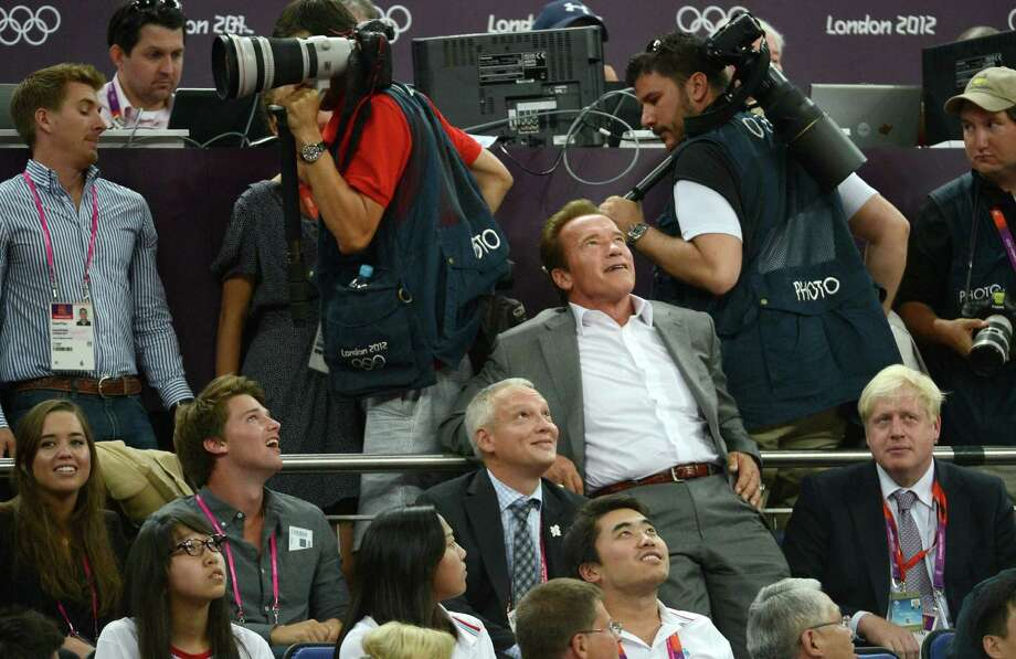 LONDON, ENGLAND - AUGUST 12: Patrick Schwarzenegger (2nd L), Arnold Schwarzenegger (2nd R) and London Mayor Boris Johnson (R) during the Men's Basketball gold medal game between the United States and Spain on Day 16 of the London 2012 Olympics Games at North Greenwich Arena on August 12, 2012 in London, England. Photo: Harry How, Getty Images / 2012 Getty Images