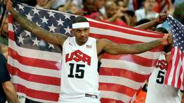 LONDON, ENGLAND - AUGUST 12: Carmelo Anthony #15 of the United States celebrates winning the Men's Basketball gold medal game between the United States and Spain on Day 16 of the London 2012 Olympics Games at North Greenwich Arena on August 12, 2012 in London, England. The United States won the match 107-100.