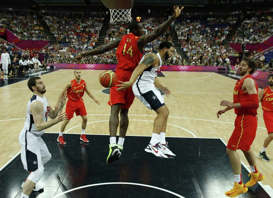 LONDON, ENGLAND - AUGUST 12: Deron Williams (C) of the United States makes a pass around Serge Ibaka of Spain to teammate Kevin Love (L) during the Men's Basketball Gold medal game between the United States and Spain on Day 16 of the London 2012 Olympics Games at North Greenwich Arena on August 12, 2012 in London, England. Photo: Pool, Getty Images / 2012 Getty Images