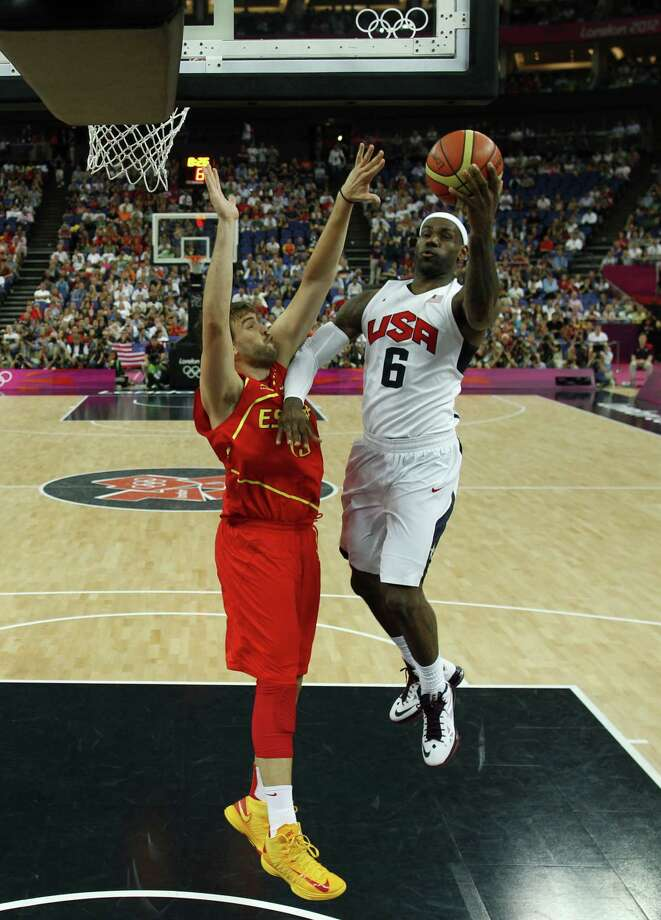 LONDON, ENGLAND - AUGUST 12: Lebron James (C) of the United States shoots over Marc Gasol of Spain during the Men's Basketball Gold medal game between the United States and Spain on Day 16 of the London 2012 Olympics Games at North Greenwich Arena on August 12, 2012 in London, England. Photo: Pool, Getty Images / 2012 Getty Images