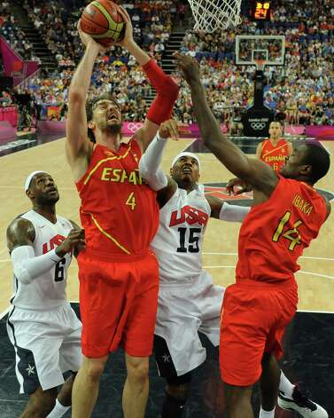 LONDON, ENGLAND - AUGUST 12: Pau Gasol (2nd L) of Spain  jumps to score over LeBron James (L) and Carmelo Anthony (R) of the United States during the Men's Basketball Gold medal game between the United States and Spain on Day 16 of the London 2012 Olympics Games at North Greenwich Arena on August 12, 2012 in London, England. Photo: Pool, Getty Images / 2012 Getty Images