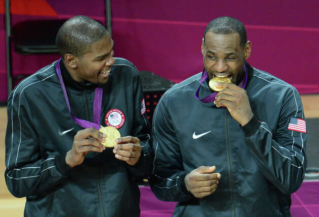 US forward Kevin Durant (L) and US forward LeBron James (R) pose with their gold medals after winning the London 2012 Olympic Games men's basketball competition at the North Greenwich Arena in London on August 12, 2012. The US won the gold medal followed by the silver to Spain and the bronze to Russia. AFP PHOTO /EMMANUEL DUNANDEMMANUEL DUNAND/AFP/GettyImages Photo: EMMANUEL DUNAND, AFP/Getty Images / AFP
